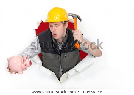 Tradesman about to break open his piggy bank Stock photo © photography33