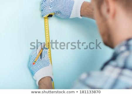 masculino · carpinteiro · parede · fita · métrica · homem - foto stock © photography33