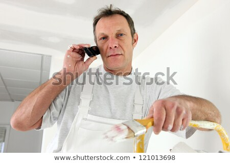 decorator interrupted by phone call stock photo © photography33
