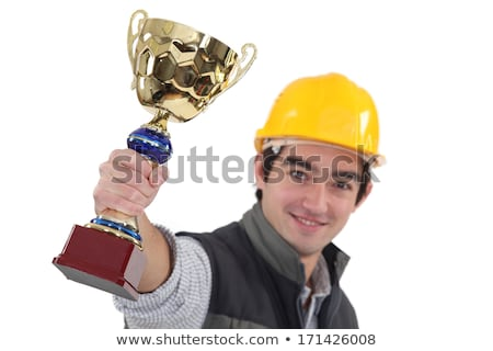 tradesman holding up a trophy stock photo © photography33