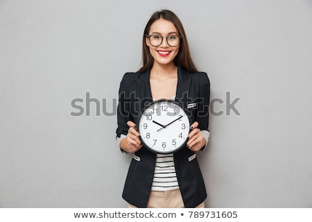 Young Businesswoman Holding Clock Stock photo © williv