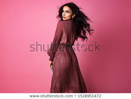 Nő rózsaszín ruha gyönyörű nő áll izolált Stock fotó © grafvision