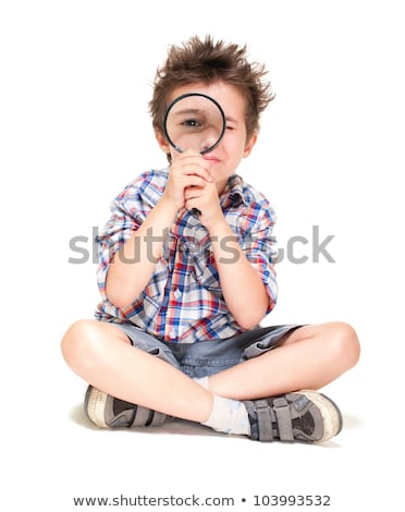 Little boy with weird hair researching using magnifier Stock photo © pekour