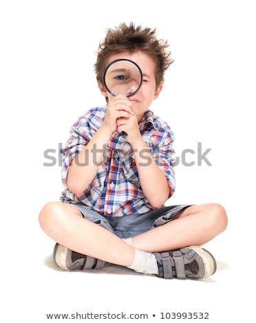 Weinig jongen weird haren vergrootglas geïsoleerd Stockfoto © pekour