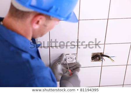 Stok fotoğraf: Electrician With A Continental Two Pin Wall Socket
