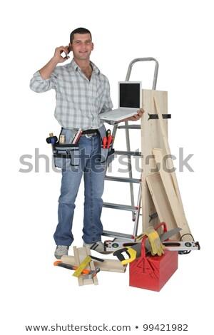 Carpenter stood with equipment making telephoning customer Stock photo © photography33