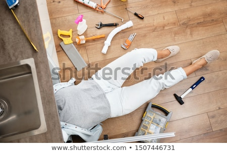plumber under a sink is working Stock photo © photography33