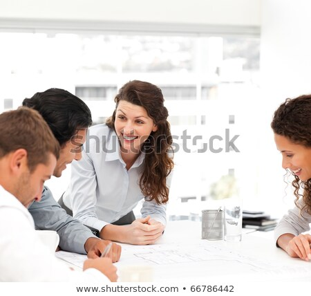 Happy female architect with her team during a meeting at the office stock photo © wavebreak_media