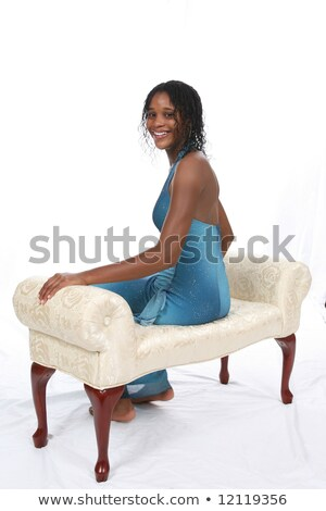 Young girl in bkack and white formal dress, sitting and smiling stock photo © jarenwicklund