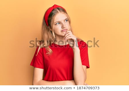Young teen girl looking up, thinking, finger to chin Stock photo © jarenwicklund