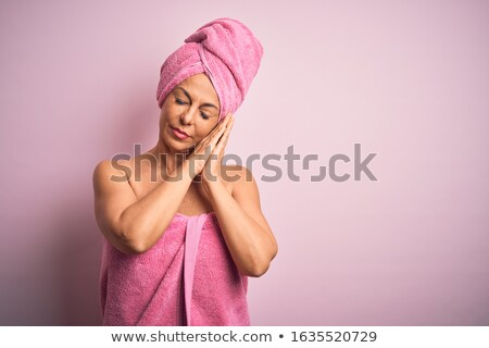 Senior woman asleep in a towel Stock photo © photography33
