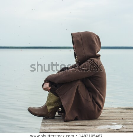girl sits on quay Stock photo © ssuaphoto