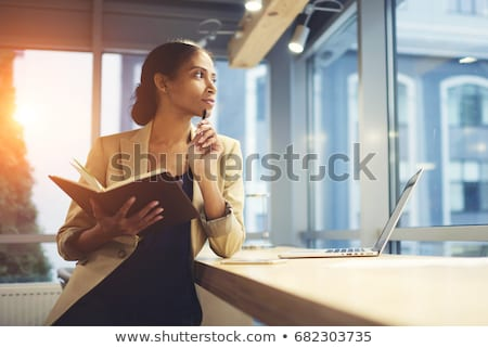 Afro-American businesswoman holding a notepad Stock photo © photography33