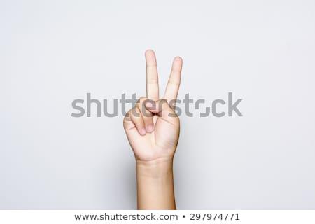 Kéz kettő ujjak felfelé béke győzelem Stock fotó © oly5