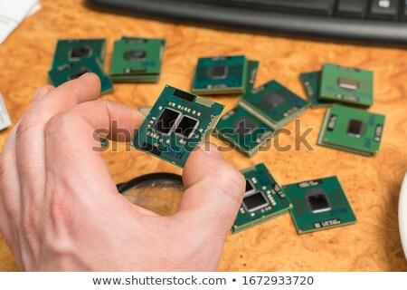 Velho microprocessador mão humana isolado branco fundo Foto stock © jonnysek