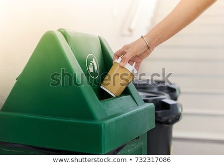 Closeup image of a woman trashes paper in office Stock photo © deandrobot