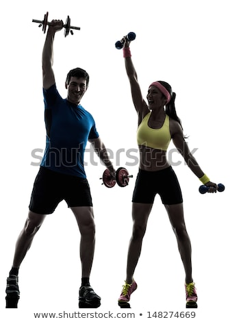sport couple   man and woman with dumbbells on the white stock photo © vlad_star