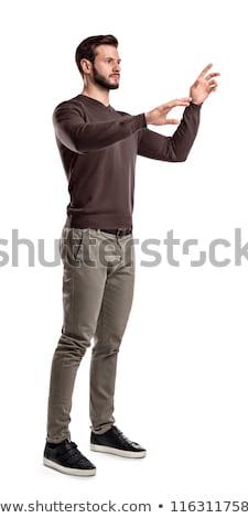 Férfi kisajtolás képzeletbeli gomb fényes kép Stock fotó © dolgachov