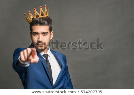 conceited business man pointing finger to head stock photo © w20er