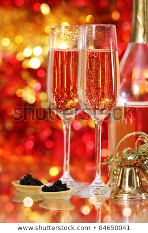 Zdjęcia stock: Two Glasses With Champagne And One Red And Golden Christmas Balls