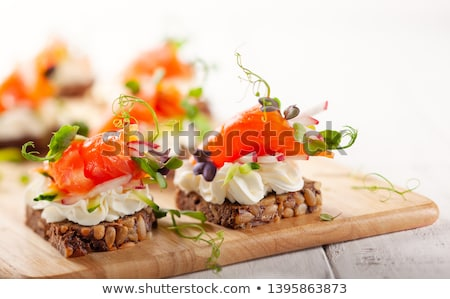 Canape with cheese and cucumber Stock photo © fanfo