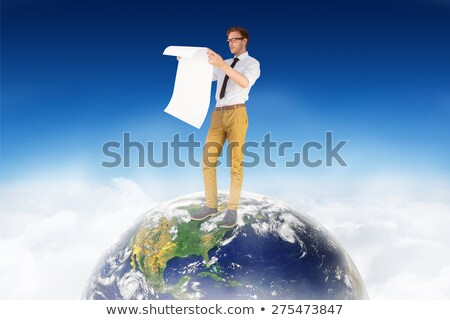 Geeky businessman reading large page Stock photo © wavebreak_media