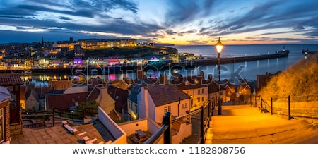 sunset from the 199 steps at whitby stock photo © chris2766
