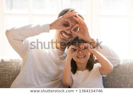 Podróbka oka okulary ręce dziecko przestrzeni Zdjęcia stock © ozaiachin