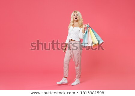 Smiling blonde with paper bags full body Stock photo © Paha_L