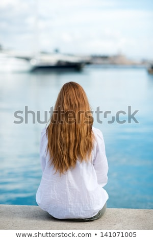 Beautiful woman sitting on the mooring Stock photo © vapi