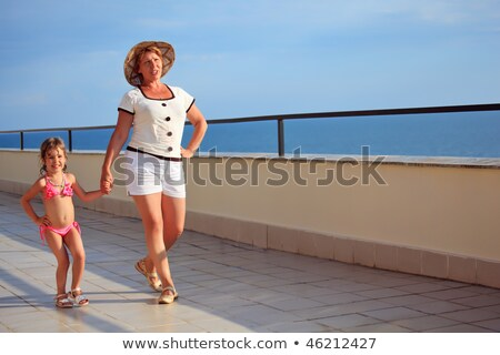 elderly woman and  little girl walk on veranda near seacoast Stock photo © Paha_L