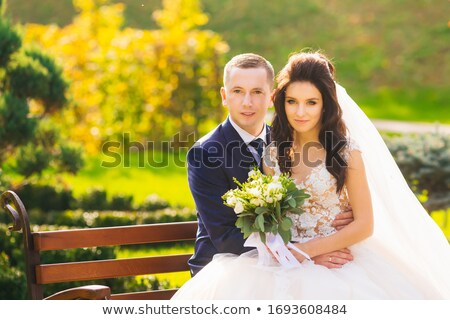 bride sits on the bench and looks at the fiance stock photo © Paha_L