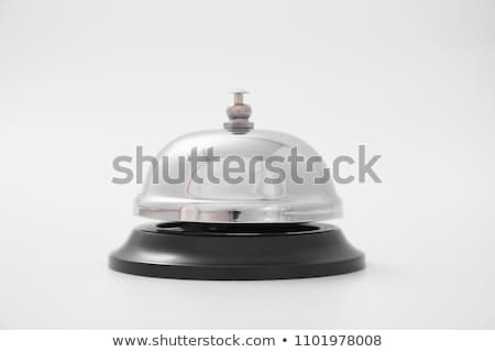 Woman ringing hotel service bell on reception desk Stock photo © stevanovicigor