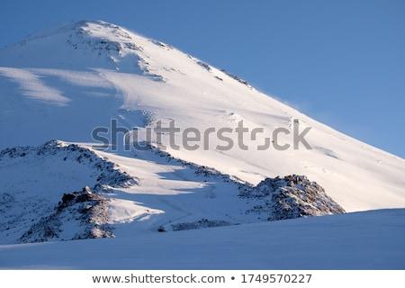 Winter mountain ridge at wind early morning Stock photo © BSANI