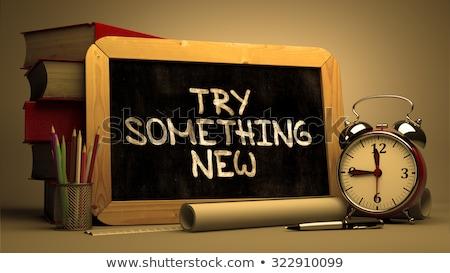Try Something New - Inspirational Quote on a Chalkboard. Stock photo © tashatuvango