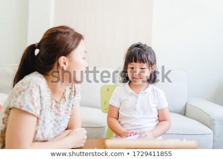 english private teacher working with asian girl stock photo © kzenon