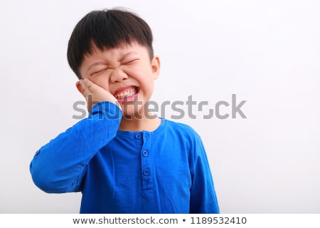 Little boy having cavity tooth Stock photo © bluering