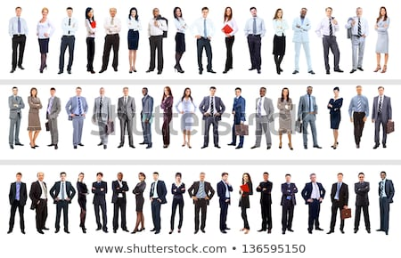 Full length portrait of businesswoman standing with hands on hips Stock photo © deandrobot