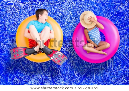 Raucous little boy and his quiet young sister Stock photo © ozgur
