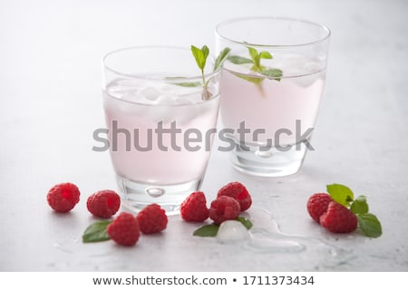 Glasses of raspberry flavored water Stock photo © Digifoodstock
