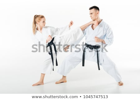 Attractive young sportsman in kimono practice in karate Stock photo © deandrobot
