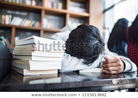 Bearded young man lies on hands in cafe Stock photo © deandrobot