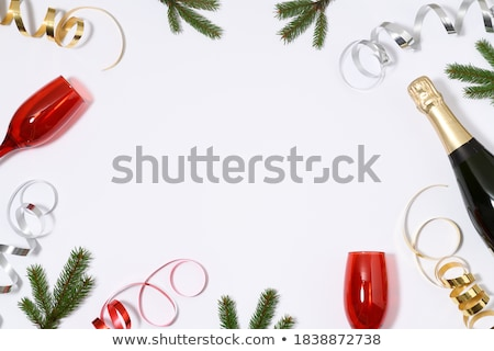Champagne bottle and flutes on the table Stock photo © dashapetrenko