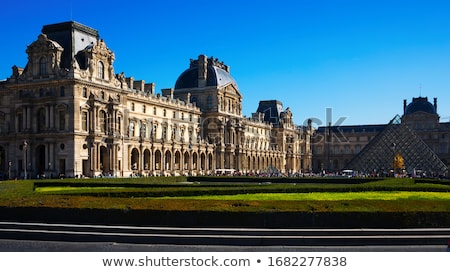louvre museum building facade in paris france stock photo © tuulijumala