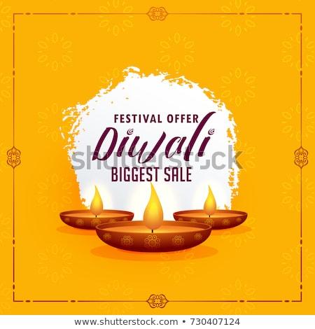 happy diwali greeting design template with three diya lamps on y stock photo © sarts