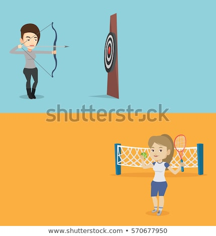 Sportswoman aiming with a bow and arrow at target. Stock photo © RAStudio