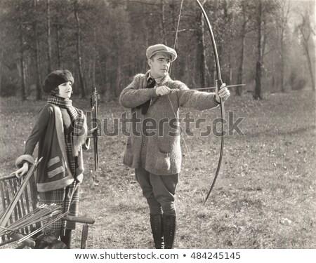Outdoor boogschieten les ouder man tonen Stockfoto © georgemuresan