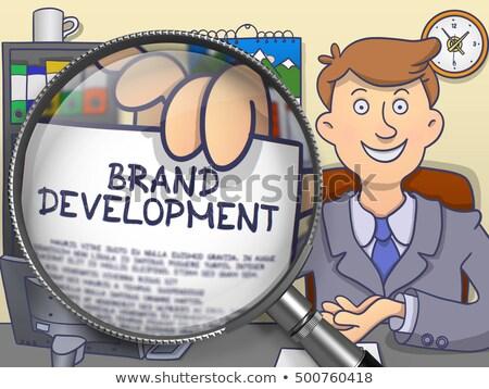 Marca strategia lente di ingrandimento doodle stile imprenditore Foto d'archivio © tashatuvango
