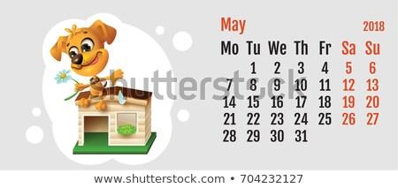 2018 year of yellow dog on chinese calendar fun dog fortune telling on chamomile calendar grid mon stock photo © orensila