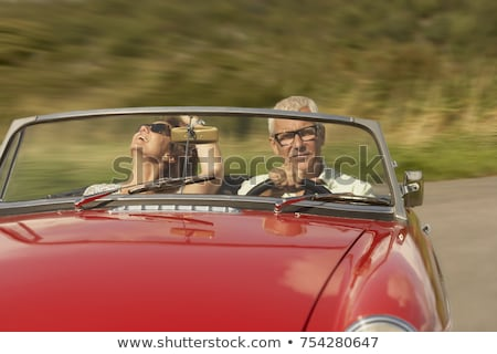 Mid aged couple in sports car Stock photo © IS2